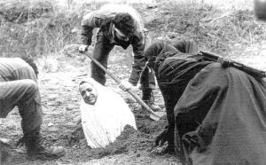 Click to Enlarge. The horror of religion. A muslim woman being prepared for stoning—after being raped.