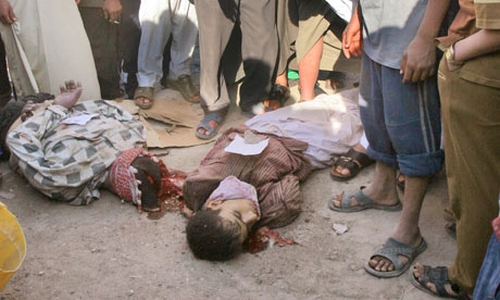 Click to Enlarge. The bodies of two gay men—bound and executed in the street in Iraq.