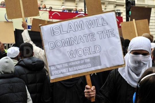 Click to enlarge. Muslims protest outside the French embassy in London